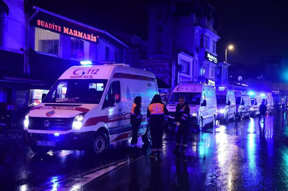 Ambulances are seen at the site of an armed attack January 1, 2017 in Istanbul. At least two people were killed in an armed attack Saturday on an Istanbul nightclub where people were celebrating the New Year, Turkish television reports said. / AFP PHOTO / YASIN AKGULYASIN AKGUL/AFP/Getty Images
